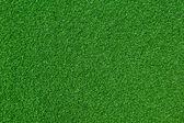 umělé zelené trávě