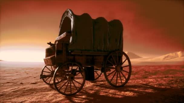 plátno potažené retro vůz v poušti při západu slunce