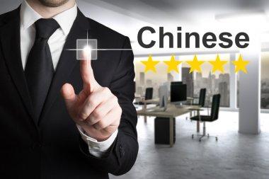 businessman translator pushing button chinese