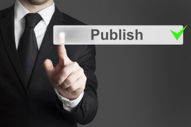 businessman pushing button publish broadcast
