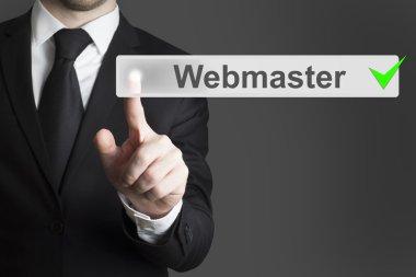 businessman pushing button webmaster