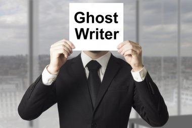 businessman hiding face behind sign ghost writer
