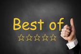 Fotografie thumbs up best of golden ratings stars black chalkboard