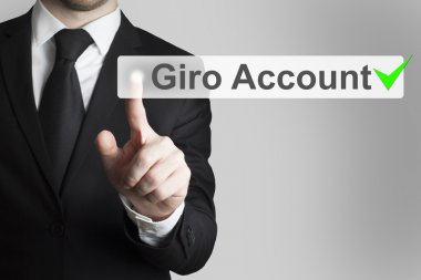 businessman pushing flat button gira account
