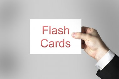 Hand holding sign flash cards