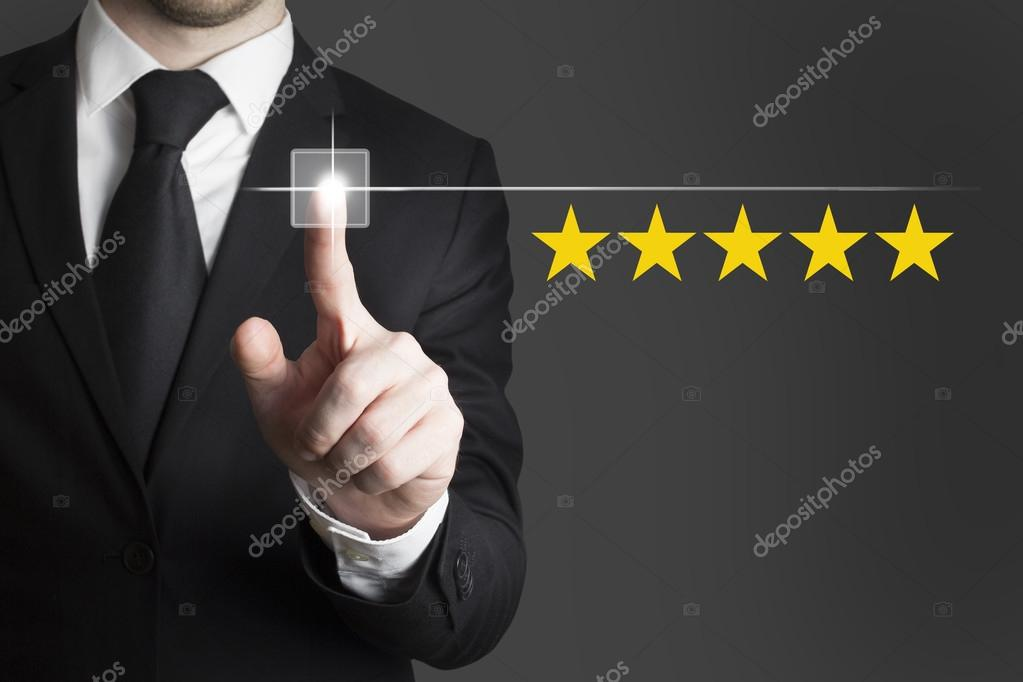 businessman pushing button five star rating