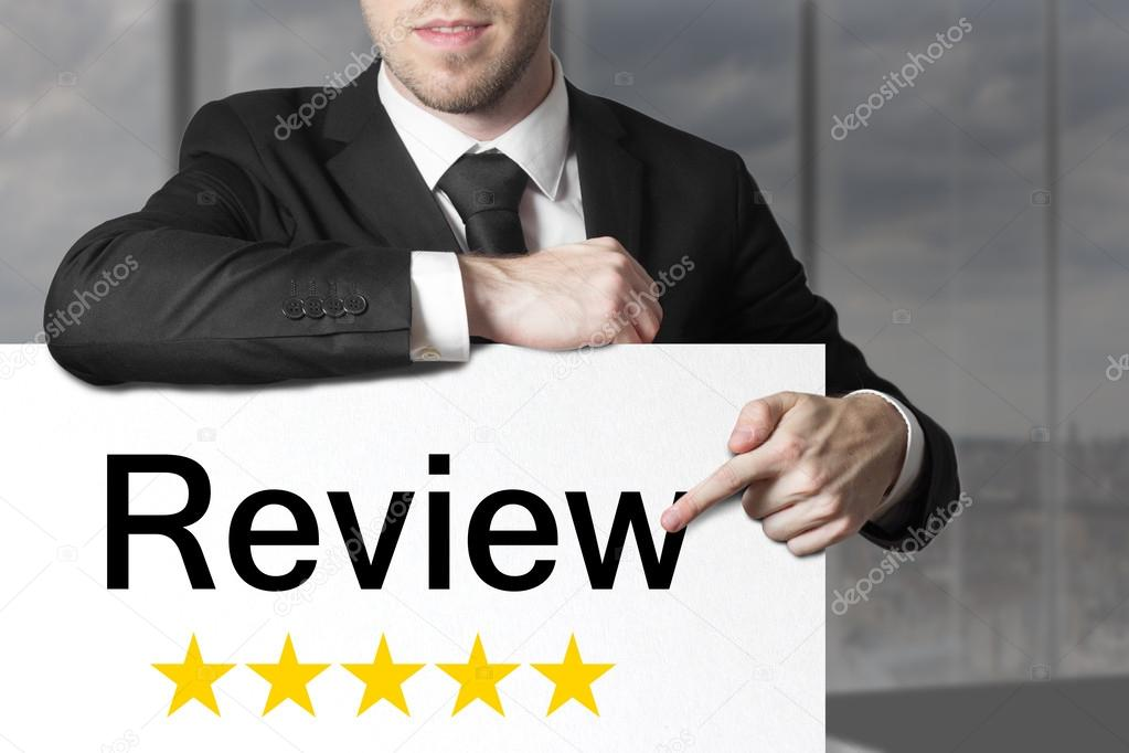 businessman pointing on sign review golden stars