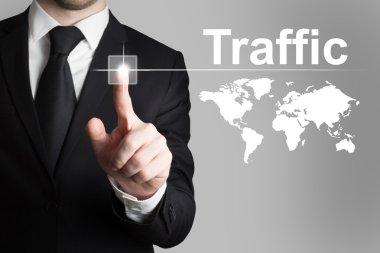Businessman pushing button traffic world map