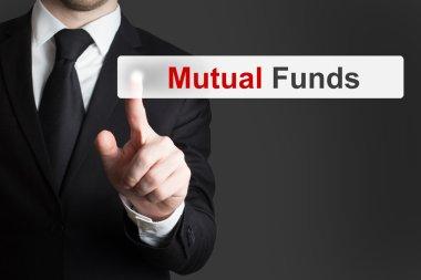 businessman pushing touchscreen button mutual funds
