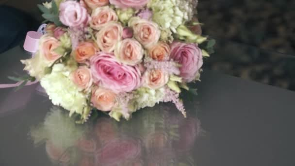 Close-up of a beautiful wedding bouquet on the table. Congratulations on Valentines Day. Flower shop. Delivery of roses, selective focus, shallow depth of field
