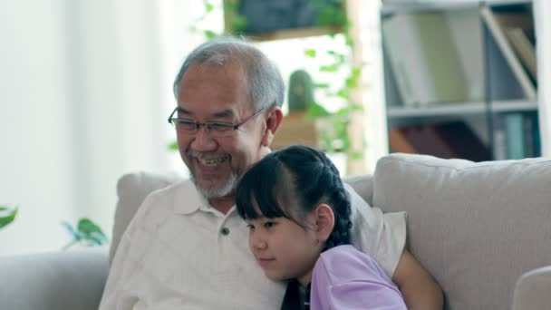 Happiness Elderly grandfather talking with grandchild together on sofa enjoy and relaxation recreation at home