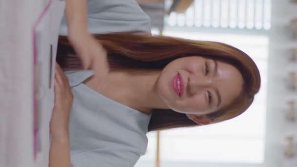 Vertical Video first views of beautiful asian young woman VDO call conference meeting with her friends or business team working at home,Attractive young girl freelance working with computer tablet