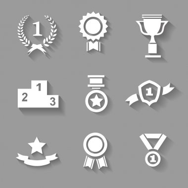 Set of white  award  success and victory icons with trophies  stars  cups  ribbons  rosettes  medals medallions  wreath