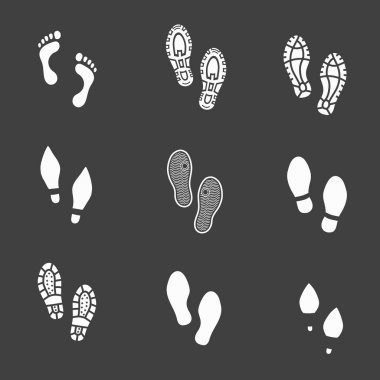 Set of footprints and shoeprints icons showing bare feet