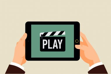 Clapperboard icon 'Play' on tablet