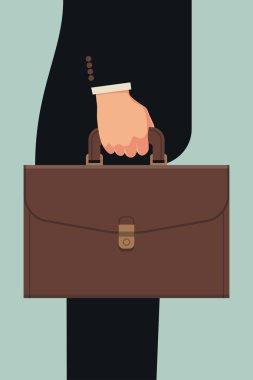 Businessman's hand holding briefcase