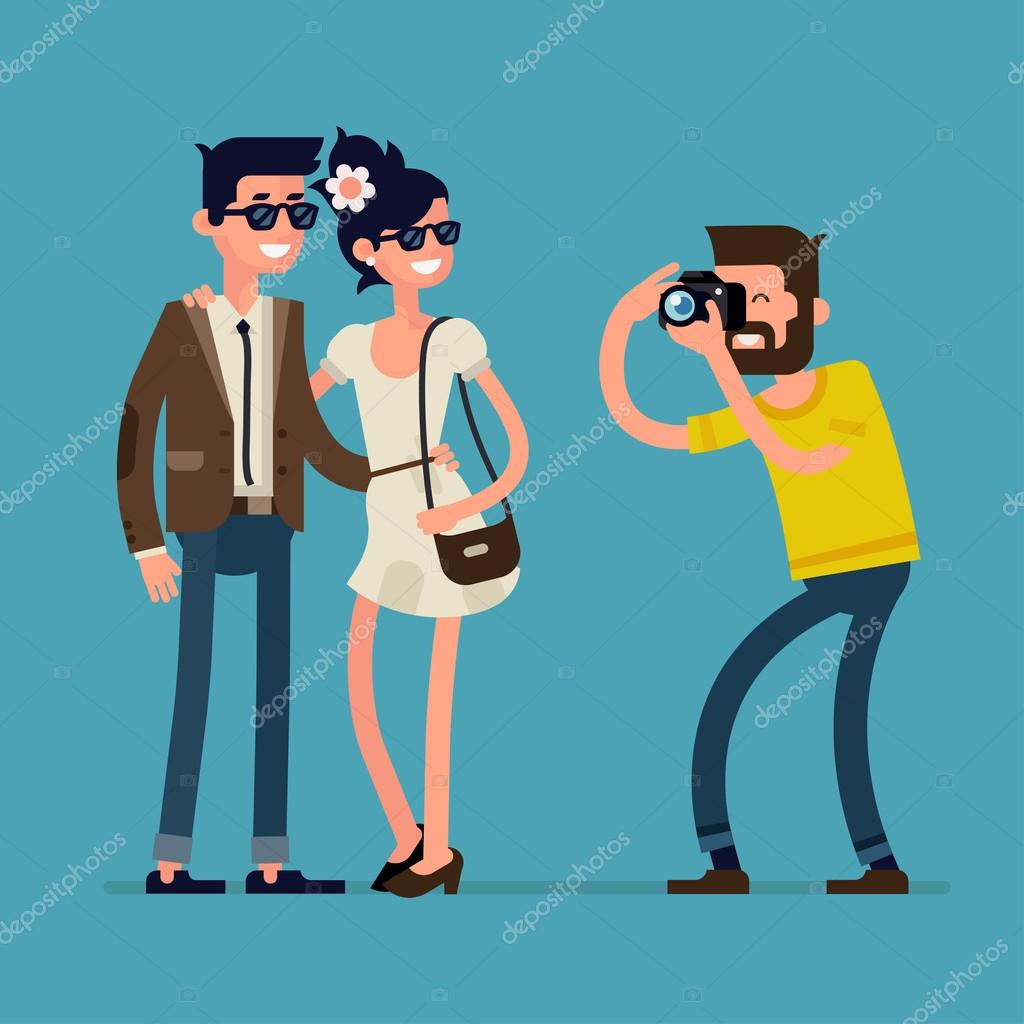 Couple with photographer taking photos