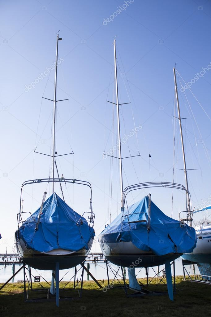 sailboats stored in a marina