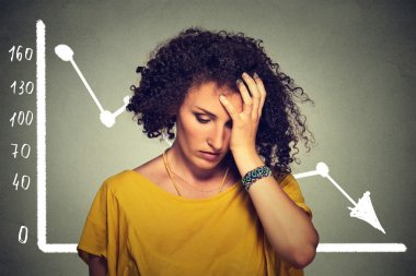 stressed sad business woman with financial market chart graphic going down