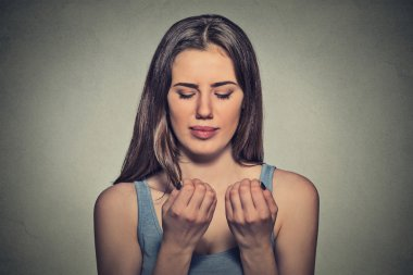 Worried woman looking at hands fingers nails obsessing about cleanliness