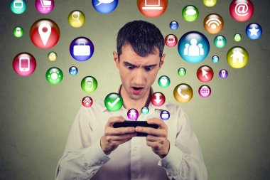 surprised man using smartphone social media application symbols icons flying out of screen