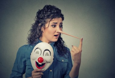 Woman with long nose and clown mask. Liar concept