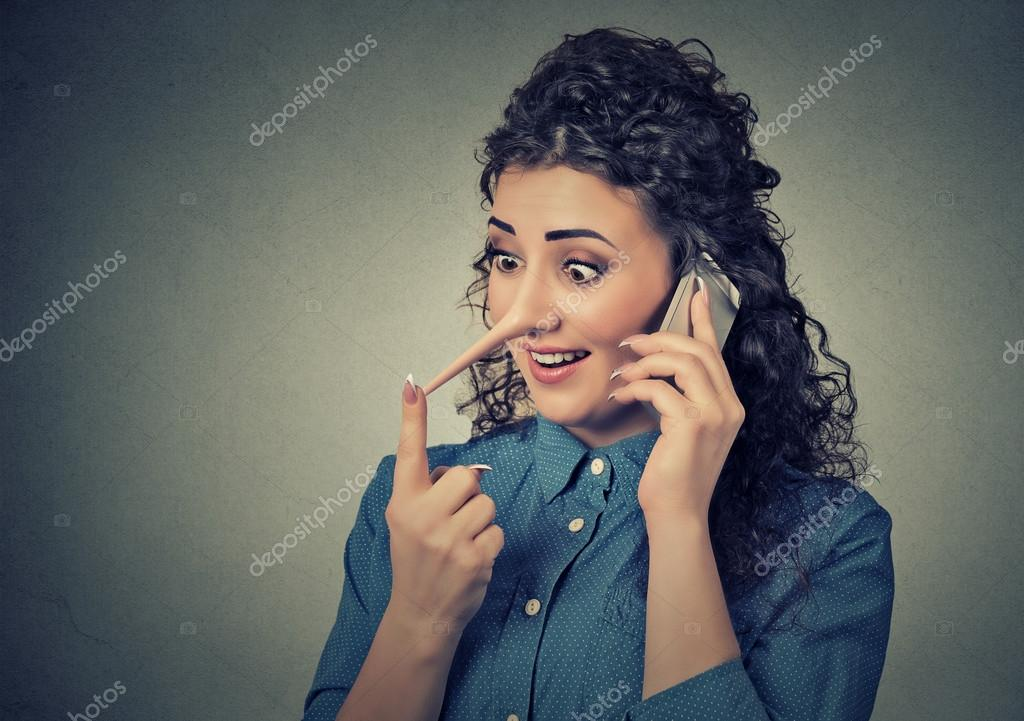 Concept of customer support liar with long nose. Woman talking on mobile phone telling lies