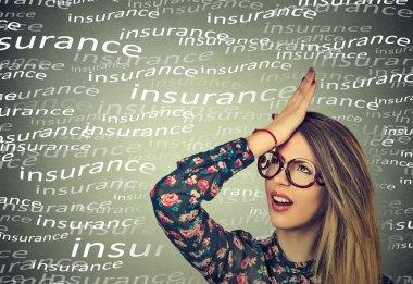 woman, slapping hand on head having duh moment. forgot to buy insurance