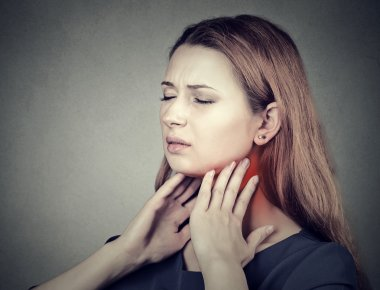 girl with sore throat neck colored in red. Sick woman having pain in throat
