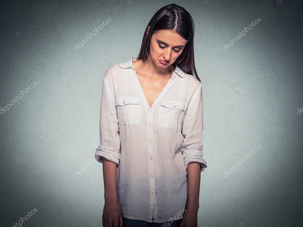 Sad shy insecure woman looking down avoiding eye contact