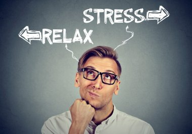 confused man thinking looking up stress or relax