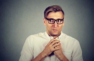 Nervous stressed man feels awkward anxiously craving something