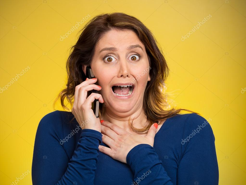 Shocked business woman funny looking employee talking on cell ph