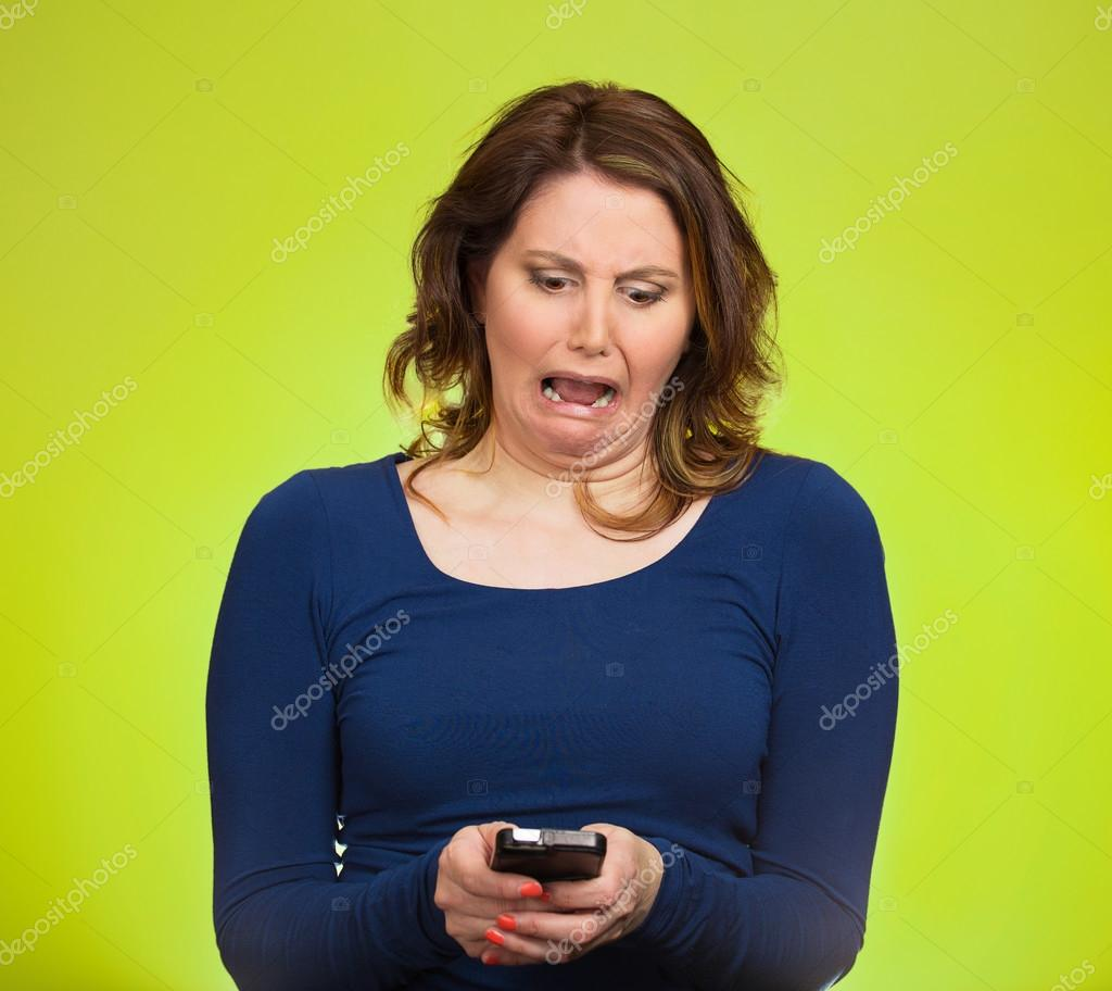 Upset woman holding cellphone