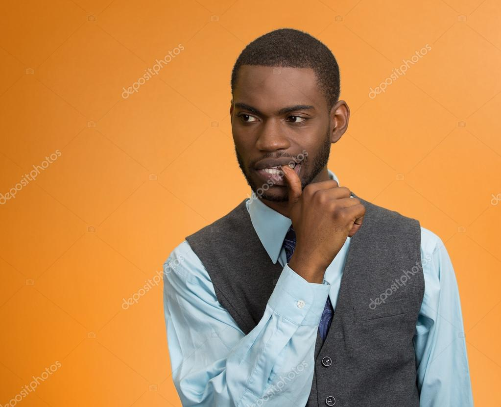 Man with finger in mouth, sucking thumb, in stress, deep thought