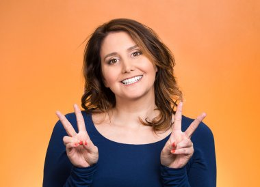 Happy woman showing victory sign