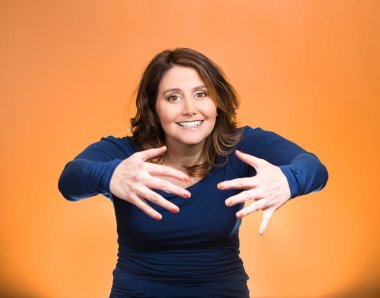 Woman with raised up palms arms at you offering hug