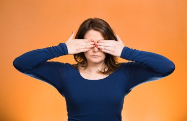 Closeup portrait young middle aged woman, closing, covering eyes with hands can't look, hiding, avoiding situation, isolated orange background. See no evil concept. Human emotions, facial expressions stock vector