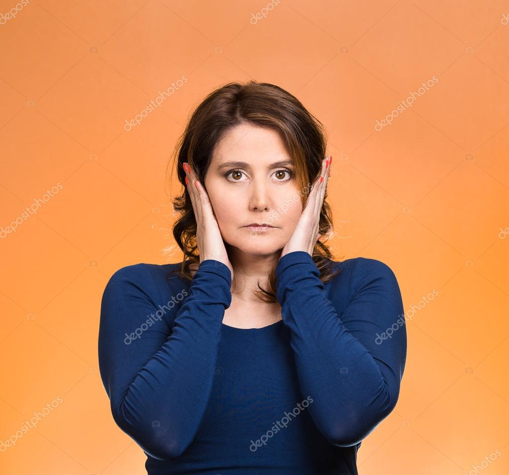 Woman, covering ears. Hear no evil concept