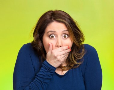 Shocked young woman, covering her mouth