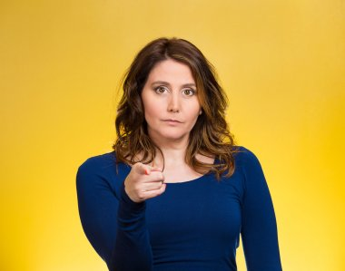 Serious woman pointing finger at someone, blaming
