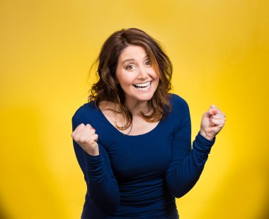 Happy ecstatic woman celebrating being winner