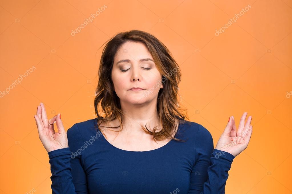 Woman relaxing, meditating, in zen mode