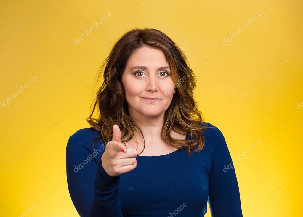 Happy woman smiling, pointing finger towards you