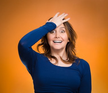Woman placing hand on head, palm on face gesture in duh moment