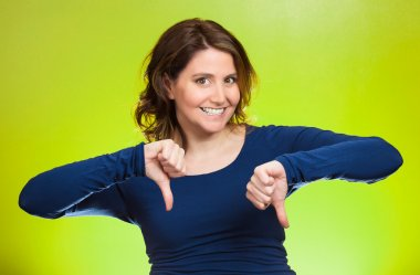 Woman showing thumbs down hand gesture, happy someone made mistake