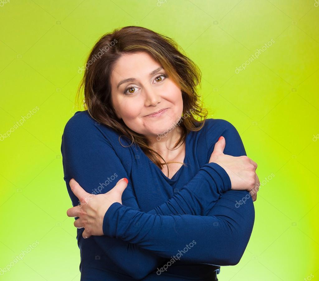 Smiling woman, holding, hugging herself