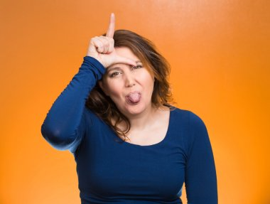 Mad pissed off woman, showing loser sign