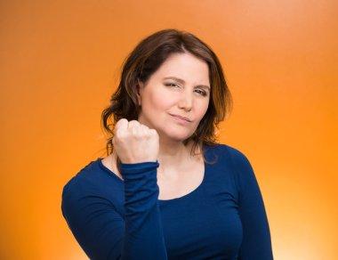 Woman worker, business employee showing fist