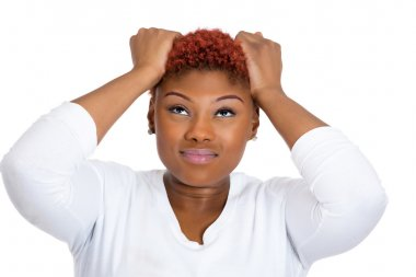 Frustrated woman pulling her hair out, having bad headache, stressed